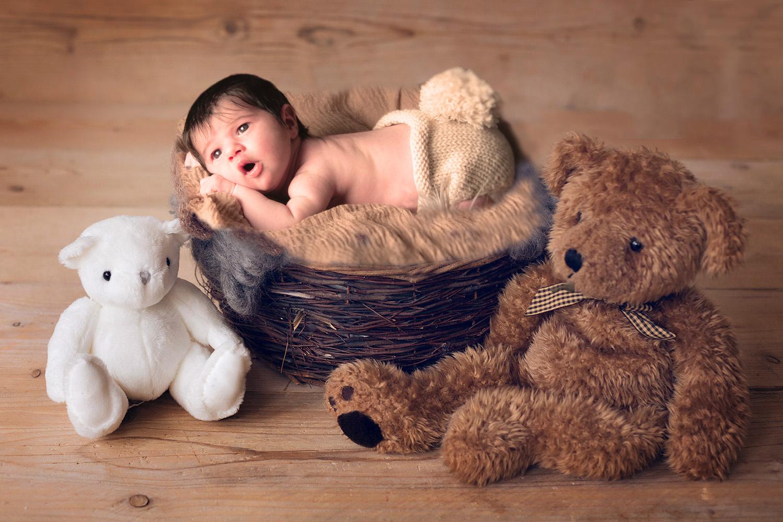 newborn-photography-ann-wo-baby-with-teddy-bears